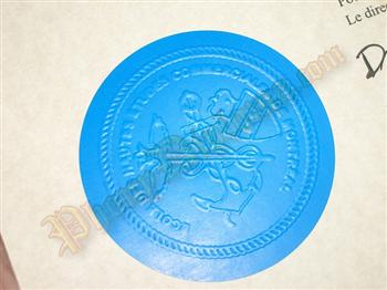 Fake diploma blue embossed emblem